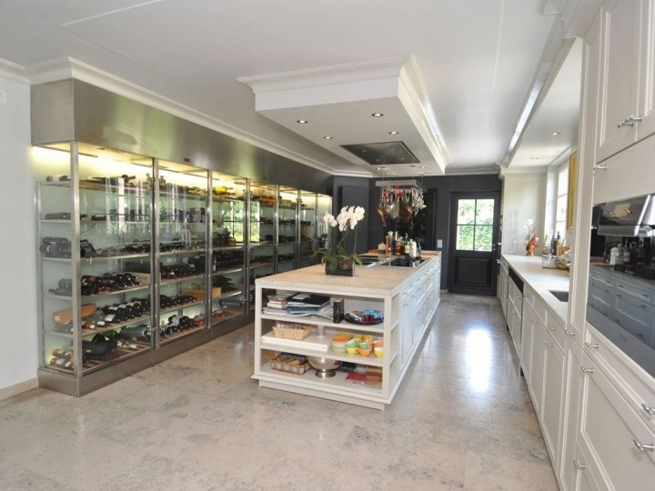 Amazing kitchen with open wine cellar.