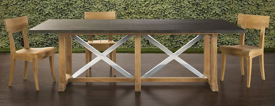 Datcha dining table from Sutherland Furniture features a teak base.