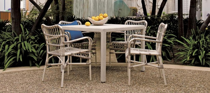 Lucy Stacking Side Chair from Janus et Cie.  The look of wicker, but made from aluminum.