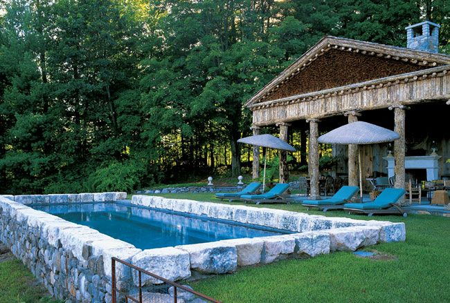 Bunny Williams designed this temple-inspired pool area.
