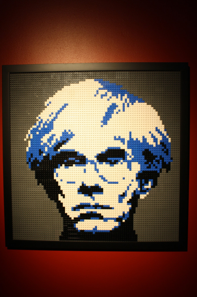 A portrait of Andy Warhol done in Lego.