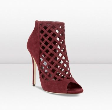 These Jimmy Choo booties add a shot of color to your look.
