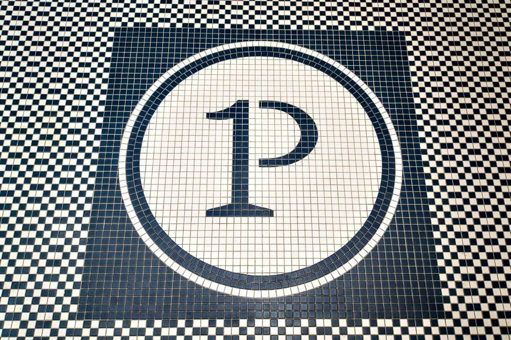 The tile floor mosaic with the Primary logo.