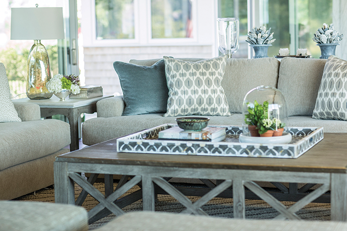 Comfortable sofas are covered in a sage green mohair and paired with a durable extra large coffee table.
